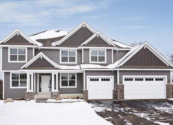 Dark grey exterior of home during winter