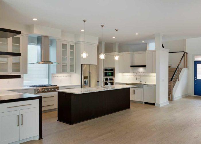 Rustic wood flooring in modern white kitchen