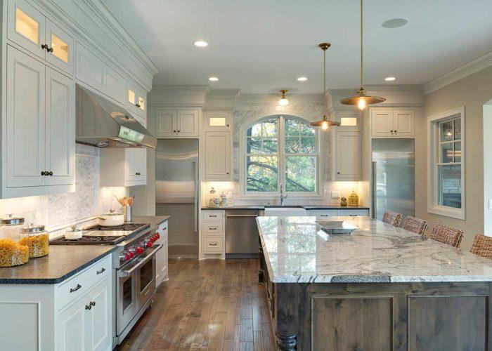 White kitchen with marble island and backsplash