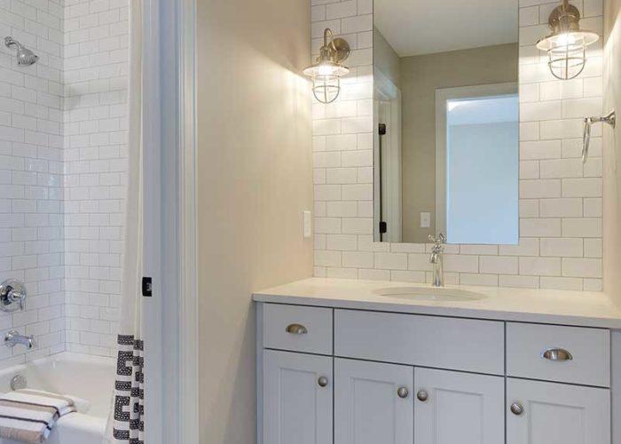 Bathroom vanity with white subway tile backsplash