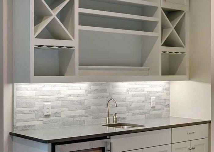 Bar area in kitchen with grey marble backsplash