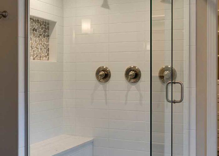 Bathroom walk in shower with three shower heads