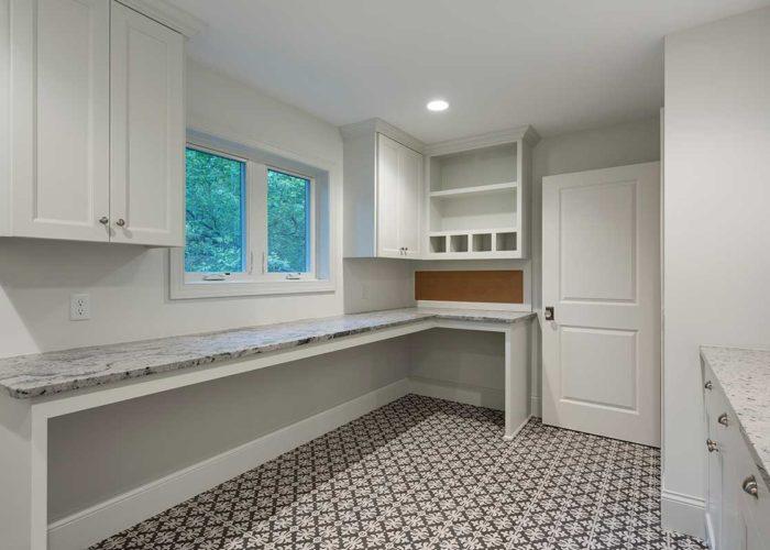 Unique tile in white laundry room