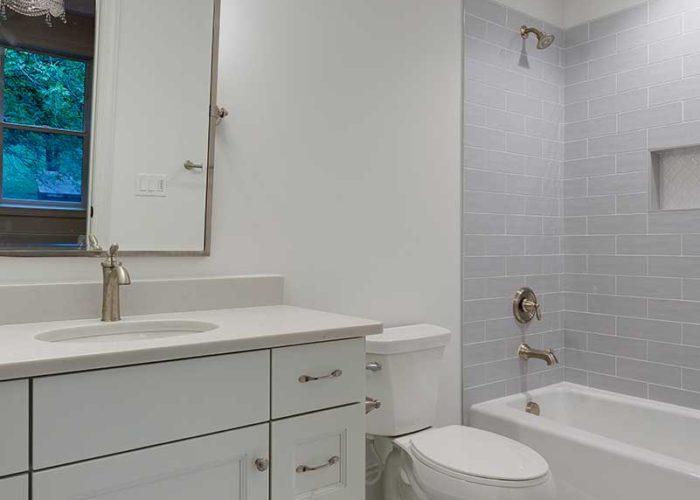 White bathroom vanity and tile floor