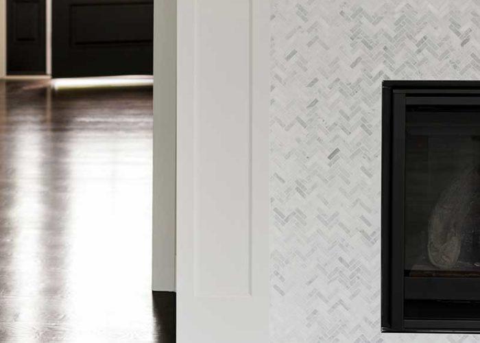 White chevron marble fireplace