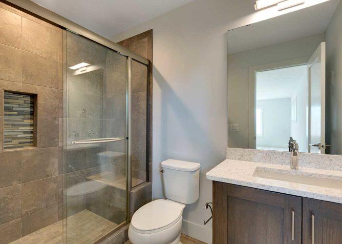 Shower with sliding glass door