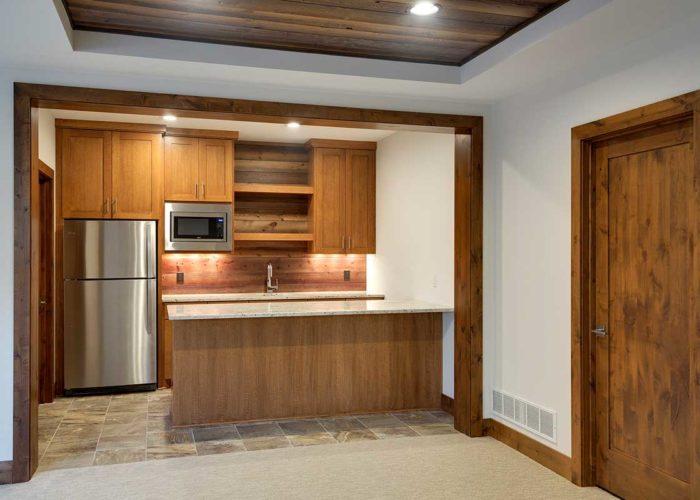 Warm wood bar area in recreation room