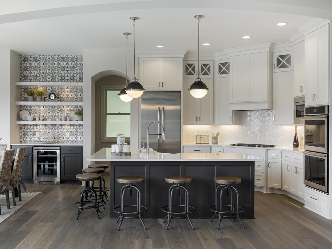 Modern white kitchen with white subway tile backsplash