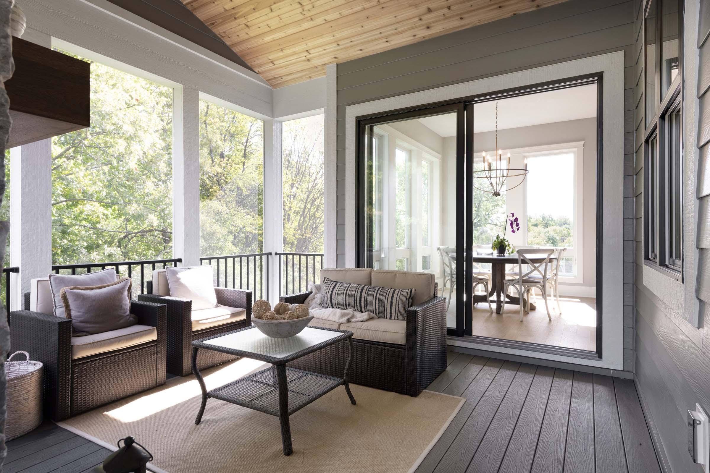 Seasonal porch with tall windows
