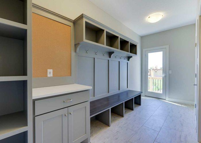 Neutral grey mudroom with cork board