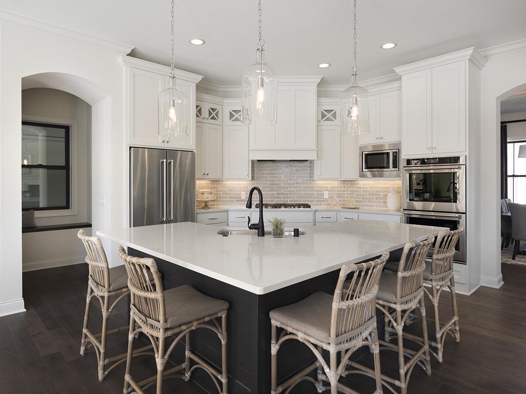 Spacious white kitchen with center island seating
