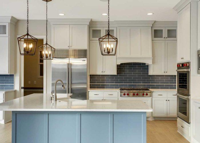 White kitchen with unique blue island