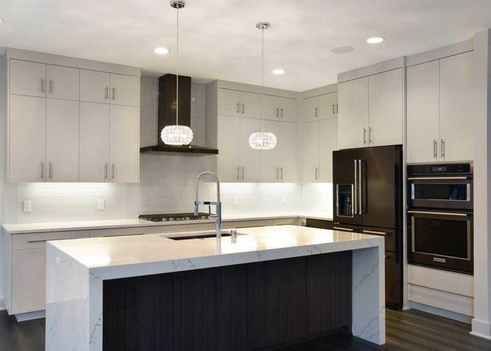 Dark appliances in modern white kitchen
