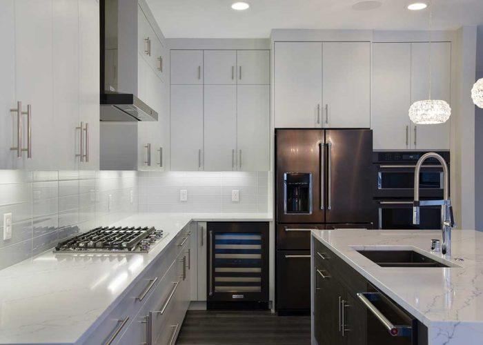 Sleek modern white kitchen with brown finish appliances