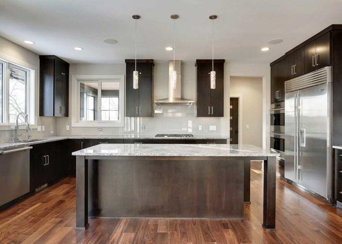 Dark wood cabinets and island in modern kitchen