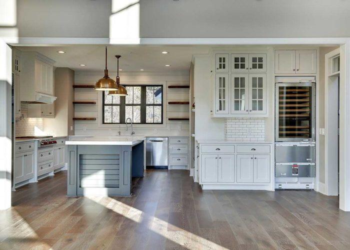 White kitchen with wood flooring