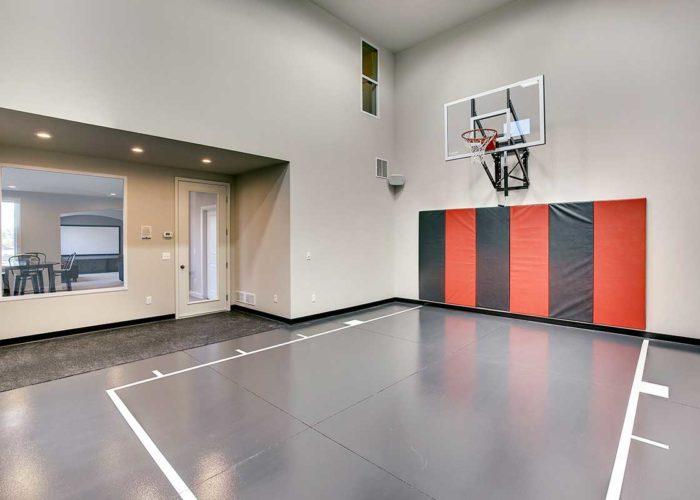 Indoor sports court with basketball hoop